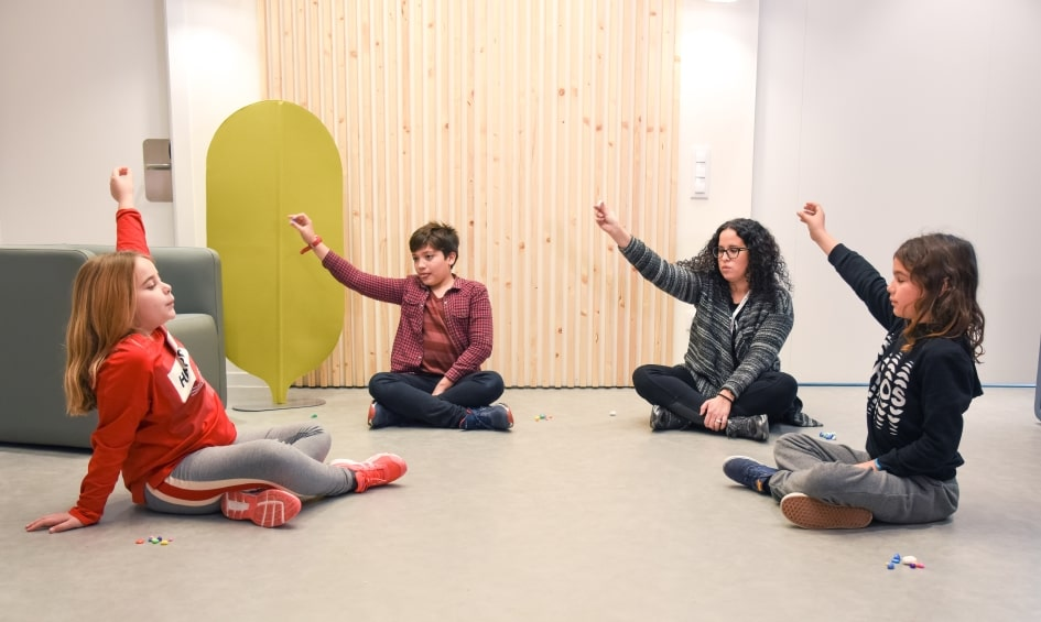 Anna Huguet, a psychologist at SJD Barcelona Children's Hospital, conducts a mindfulness session with patients from the centre