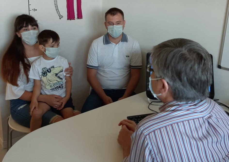 Dr Jaume Mora seeing Daniyl's family in his consulting room